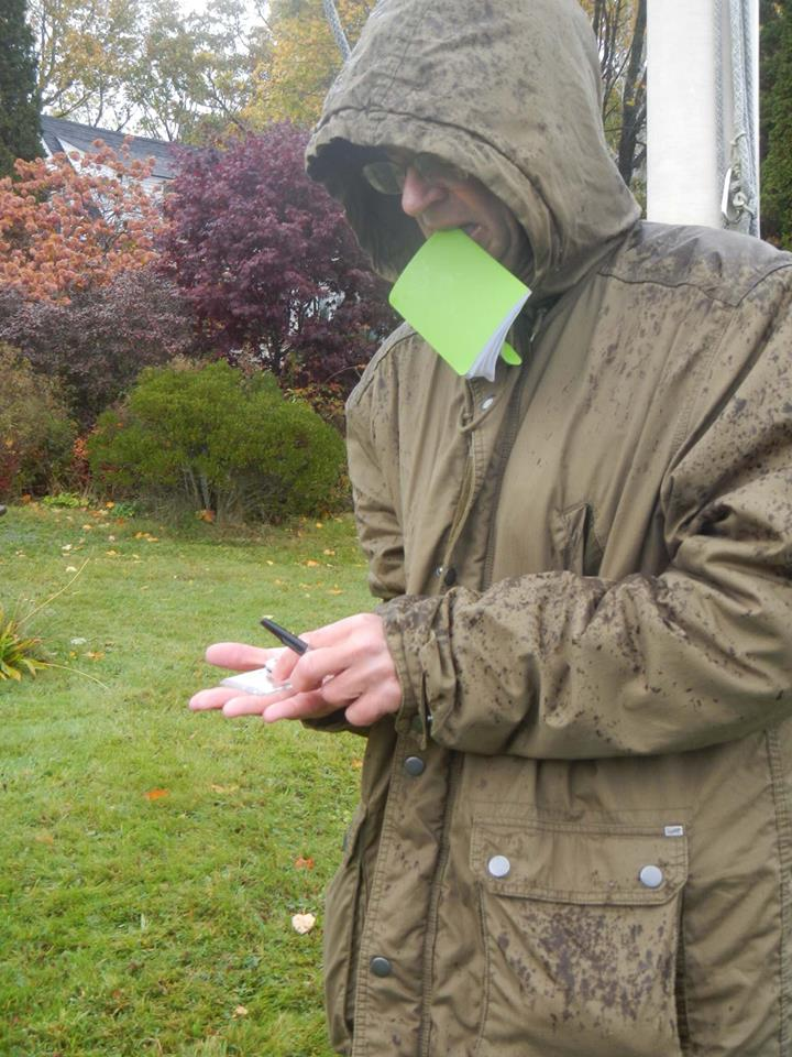 Nelson keeps his notebook dry while taking a compass bearing.