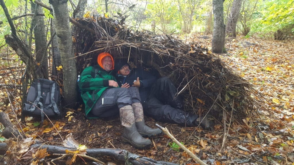 Kris showing us that two people can fit in his shelter. Photo credit: Angela Snowman